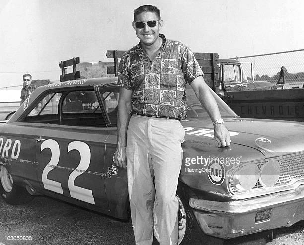 Fireball Roberts poses with his Holman-Moody Ford that he drove to four wins during the year, including the Firecracker 400 at Daytona International...