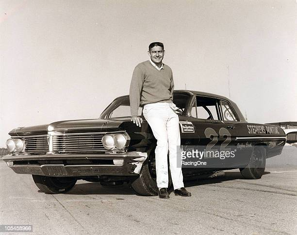 Fireball Roberts poses with Smokey YunickÕs factory Pontiac at Daytona International Speedway Roberts would go on to win the Daytona 500 NASCAR Cup...