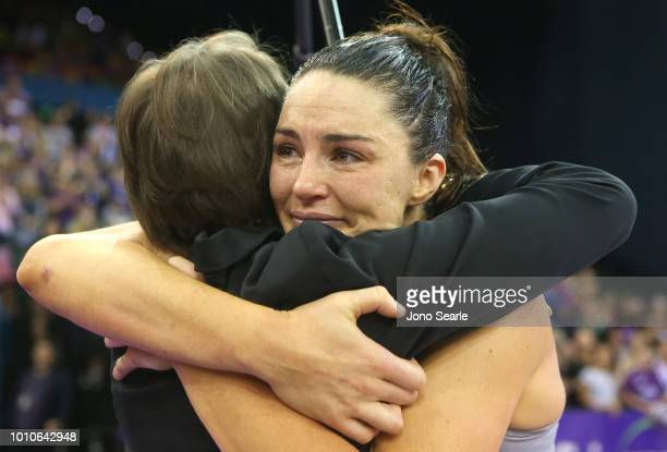 Firebirds coach Roslee Jencke hugs Sharni Layton of the Magpies after the game of the round 14 Super Netball match between the Firebirds and the...