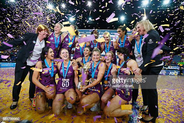 Firebirds players celebrate during the 2016 ANZ Championship Grand Final match between the Queensland Firebirds and the NSW Swifts at Brisbane...