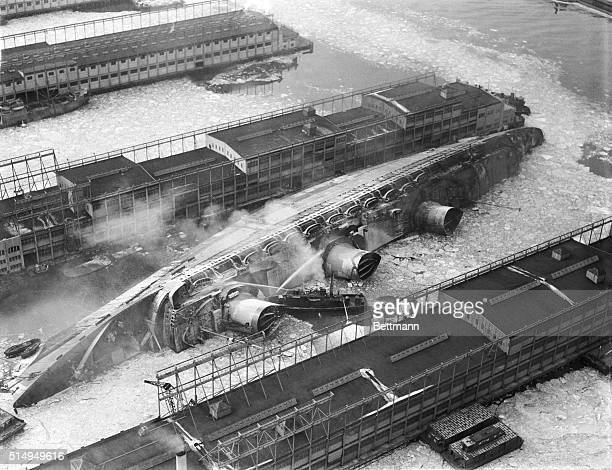 Fireboats try to rescue workers trapped aboard the capsized and burning ship USS Lafayette formerly the Normandie in New York Harbor