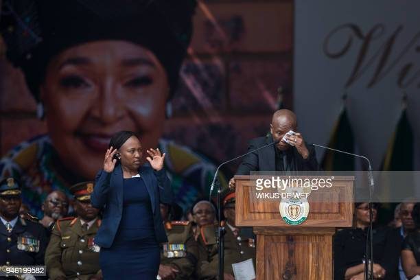 TOPSHOT Firebrand opposition politician Julius Malema leader of the Economic Freedom Fighters reacts as he speaks during the funeral of antiapartheid...