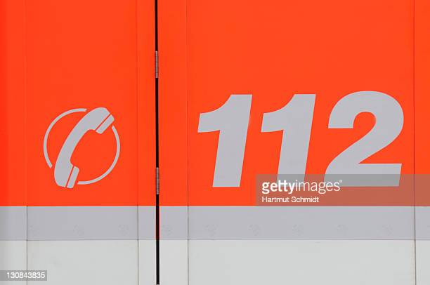 Fire-brigade emergency phone number 112 on the body of a fire engine, pictogram, telephone receiver, European-wide emergency call number
