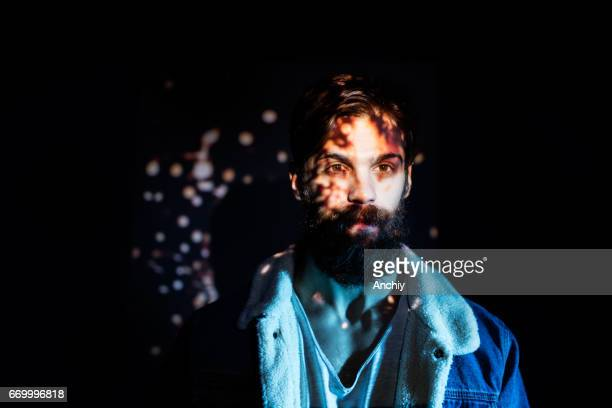 firecracker spark image projected on a young man upper body - projection equipment stock pictures, royalty-free photos & images