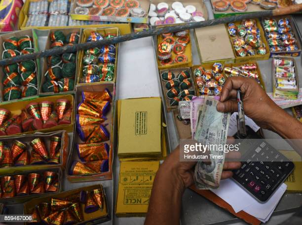 Firecracker vendors sell crackers after the ban upon its sale in capital at Jama Masjid on October 9 2017 in New Delhi India In an effort to check...