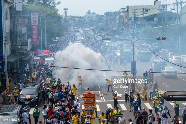 Firecrackers are let off on day two of the nine day Mazu pilgrimage on April 14 2018 in Dadu Taiwan The annual Mazu Pilgrimage begins at Jenn Lann...