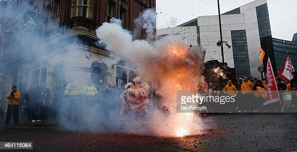 Firecrackers are lit during the performance of a traditional lion dance as the Chinese community come together to welcome in the Chinese New Year on...