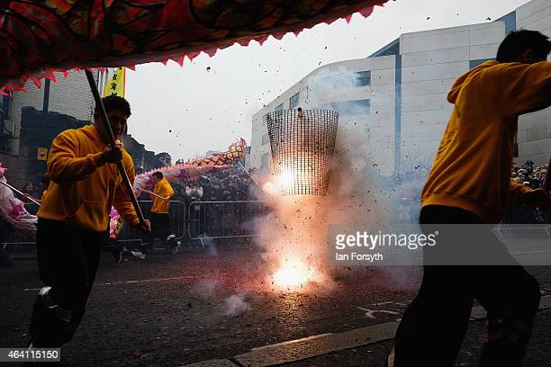 Firecrackers are lit traditional during the performance of a traditional dragon dance as the Chinese community come together to welcome in the...