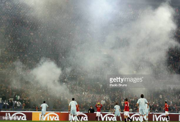 Firecrackers are set off during the Serie A match between Roma and Lazio at Stadio Olimpico on December 6 2009 in Rome Italy