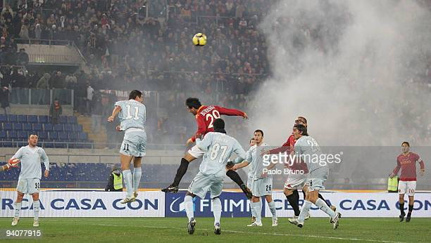 Firecrackers disrupts play during the Serie A match between Roma and Lazio at Stadio Olimpico on December 6 2009 in Rome Italy