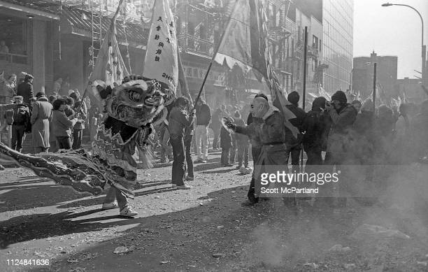 Firecrackers explode around dancers as they perform a traditional Lion Dance during the annual Chinese New Year celebrations on Mott Street in the...
