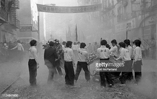 Firecrackers explode around performers during the annual Chinese New Year celebrations on Mott Street in the Chinatown neighborhood New York New York...