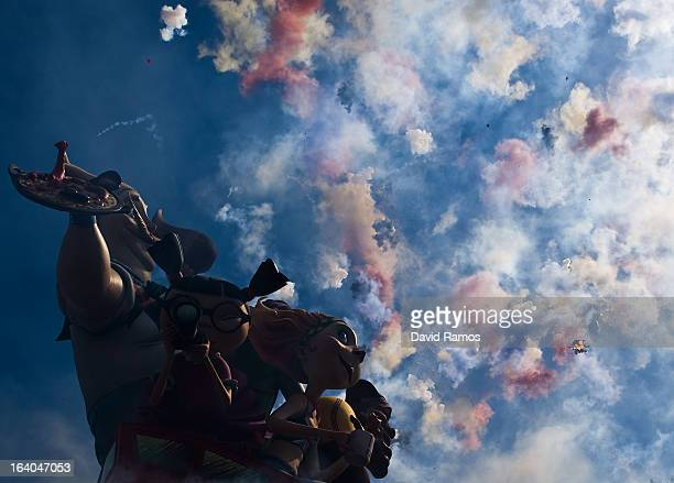 Firecrackers explote next to a Falla during the 19th 'Mascleta', an explosive barrage of firecrackers and fireworks celebrating the arrival of the...