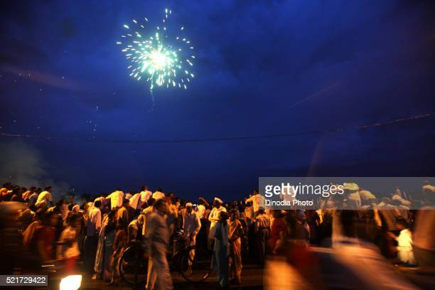 Firecrackers light sky after immersion of statue of lord Ganesh, Sangli, Maharashtra, India