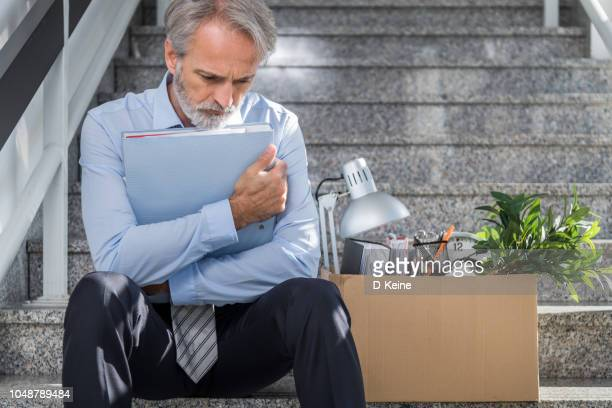 fired businessman - downsizing unemployment stock pictures, royalty-free photos & images