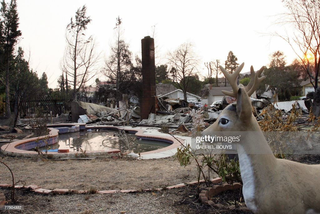 A fire-destroyed house is seen 25 October 2007 in Rancho Bernardo, California. US President George W. Bush assured victims of California's devastating wildfires that Washington would help them battle the blazes and stick with them as they fight to rebuild their lives.
