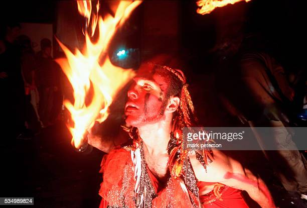 Fireeater entertain partygoers at the 20000 square foot Lunatarium warehouse space in Brooklyn's Dumbo neighborhood Photo by Mark Peterson/Corbis SABA
