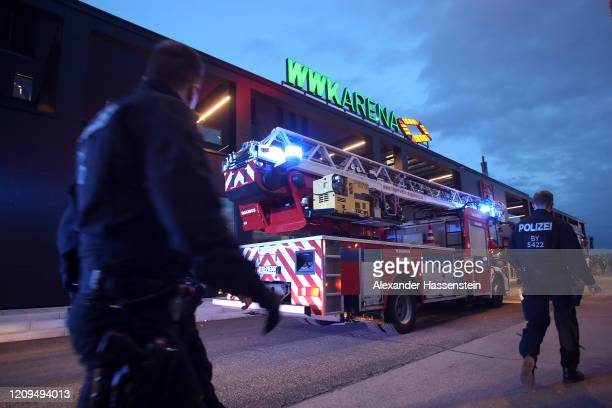Firefighter and police arrived after the Bundesliga match between FC Augsburg and Borussia Moenchengladbach at WWK-Arena on February 29, 2020 in...