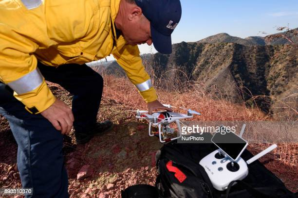 Firefighter and remote drone pilot David Danielson sets up a drone during a demonstration by the Los Angeles Fire Department in Los Angeles...