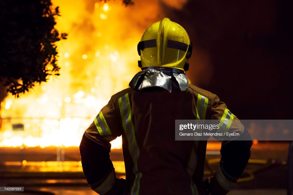 Firefighter At Night : Stock Photo