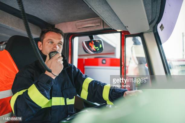 firefighter at work - firefighter stock pictures, royalty-free photos & images