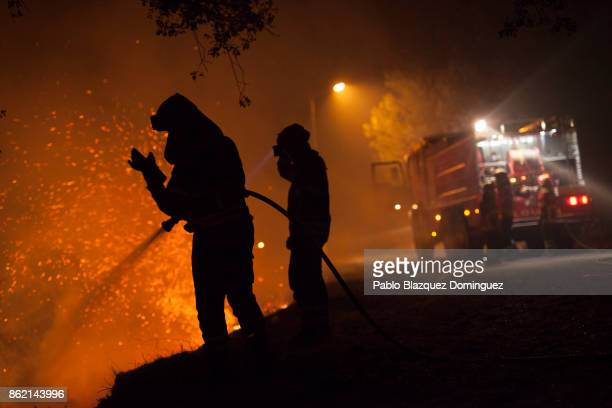 Firefighter battle a forest wildfire next to Vilarinho village near Lousa on October 16 2017 in Coimbra region Portugal At least 36 people have died...
