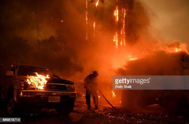 A firefighter battles the Thomas Fire along Highway 33 in Casita Springs in Ventura County Tuesday
