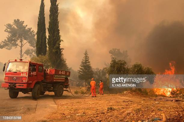 Firefighter battles with fire during a massive wildfire which engulfed a Mediterranean resort region on Turkey's southern coast near the town of...
