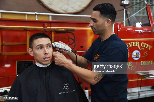 Firefighter Brett Nagel and barber Javier Oregel attend the MOVEMBER Kickoff Event with Tarek El Moussa and Jason O'Mara at the Culver City Fire...