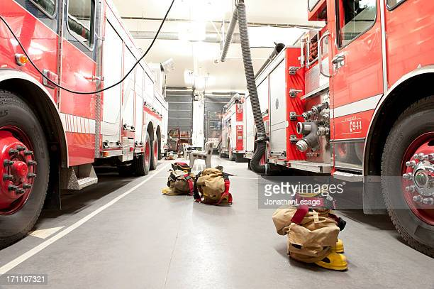firefighter bunker suit ready for action - fire station stock photos and pictures