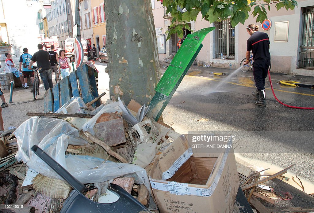 A firefighter cleans up a street on June 16, 2010 in the French southeastern city of Trans-en-Provence, in the aftermath of flooding in the area. Rescuers airlifted survivors and searched for missing people in southern France today after heavy storms triggered flash floods that killed at least 19 people.