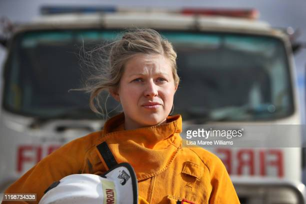 Firefighter Courtney Orrin returns to base camp following night shift at the fire front on January 11 2020 in Kingscote Australia Courtney a primary...