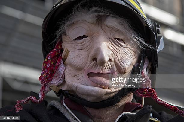 A firefighter dressed as the witch Befana attends the annual Befana celebration in Plebiscito square in Naples Italy on January 6 2017