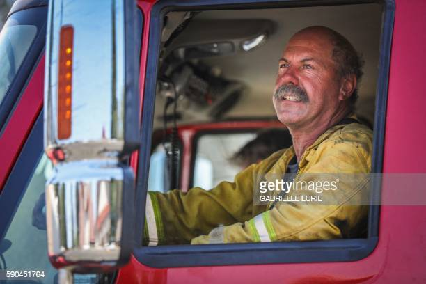 A firefighter drives a firetruck while helping in the aftermath of the Clayton Fire in Lower Lake California August 16 2016 A man was arrested and...