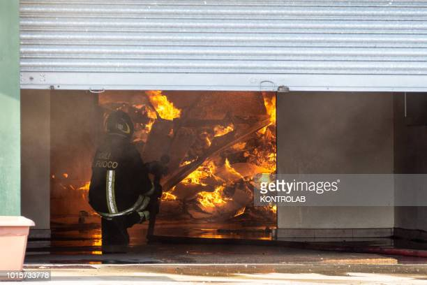 IRENE ROSSANO CALABRIA ITALY Firefighter during the phases of extinguishing a large fire that destroyed a shed with Cash and Carry activities in the...