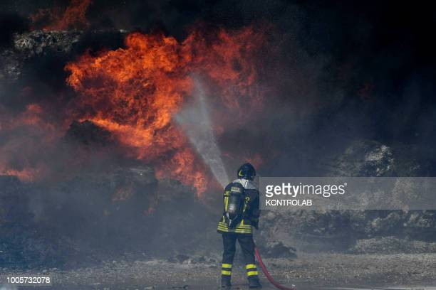 Firefighter during the phases of extinguishing the fire of a waste recycling factory, of the De Gennaro group, in the industrial area of Pascarola,...