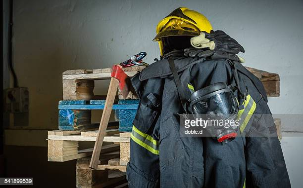 firefighter equipment ready for intervention - fire protection suit - fotografias e filmes do acervo