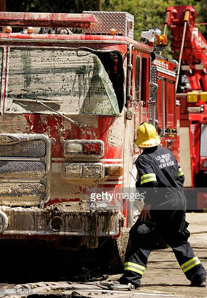 Firefighter Franco with the Los Angeles Fire Department Heavy Rescue directs the recovery of Los Angeles Fire Engine 60 that was accidentally caught...