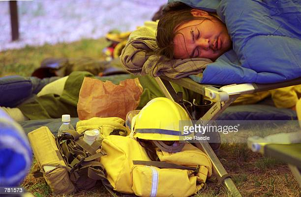 A firefighter from Santa Fe gets some much needed sleep as fires continue to sweep across 36000 acres of land May 13 2000 near Los Alamos NM The fire...