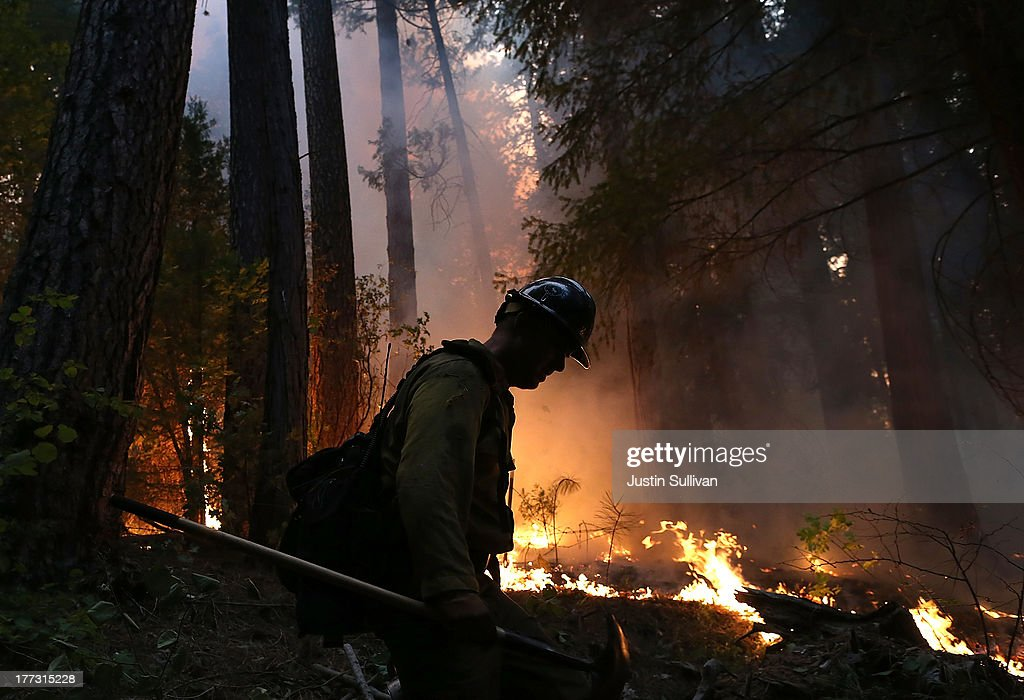 A firefighter from the Colorado based Long Canyon Fire Department monitors a back fire while battling the Rim Fire on August 22, 2013 in Groveland, California. The Rim Fire continues to burn out of control and threatens 2,500 homes outside of Yosemite National Park. Over 1,000 firefighters are battling the blaze that was reduced to only 2 percent containment after it nearly tripled in size overnight.