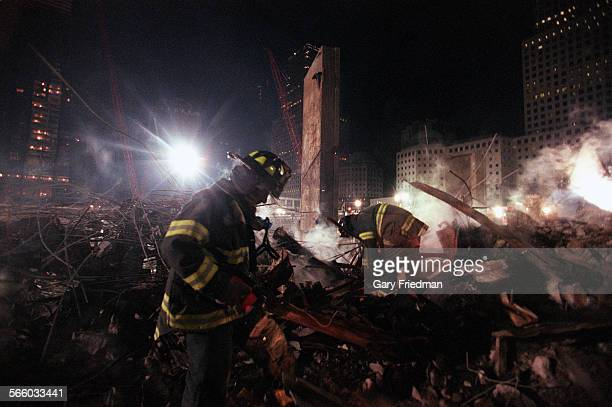 Firefighter from the Rescue 5 company search for victims in the pile at Ground Zero in December 2001 Eleven members of the company were killed in the...