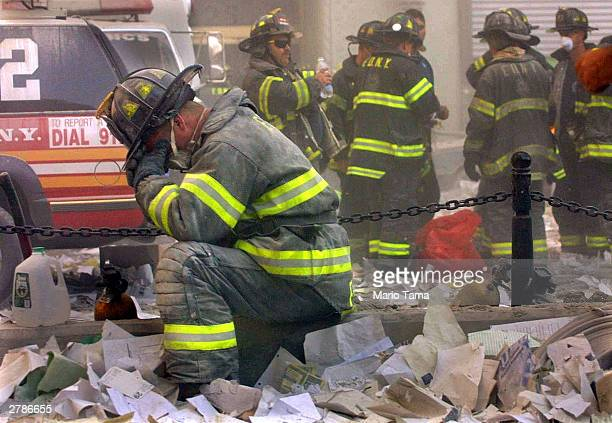 Firefighter breaks down after the World Trade Center buildings collapsed September 11, 2001 after two hijacked airplanes slammed into the twin towers...