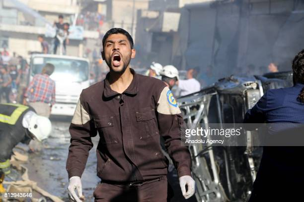 A firefighter gestures during the works to extinguish the fire after a bombladen vehicle attack in Azaz district of Aleppo Syria on January 13 2017...