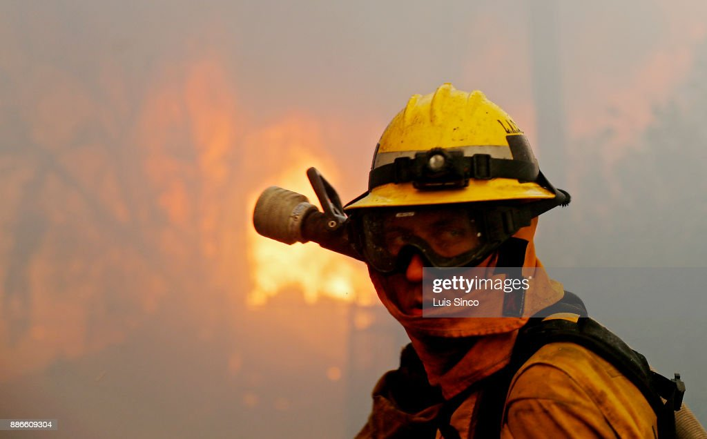 A firefighter gets into position to battle the Creek Fire as a house is engulfed in flames near the intersection of Johanna Avenue and McBroom Street in Shadow Hills on Tuesday, Dec. 5, 2017. The fire started at about 3:42 a.m. in the area of Gold Creek and Little Tujunga roads and has burned more than 11,000 acres.