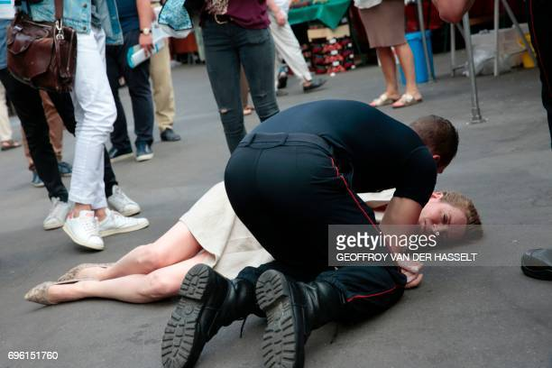 TOPSHOT A firefighter gives assistance after Les Republicains party candidate Nathalie KosciuskoMorizet collapsed after an altercation with a...