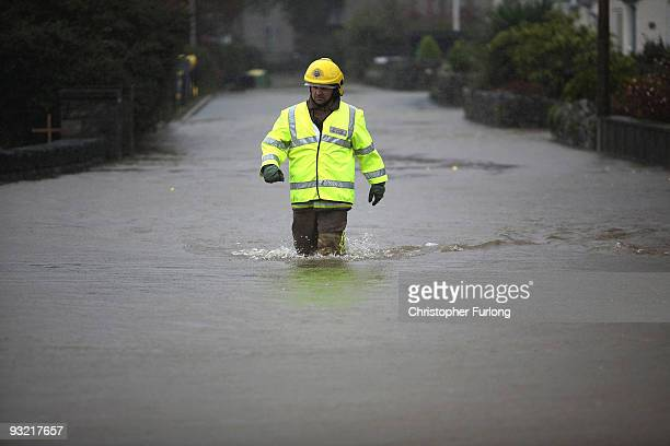 A firefighter goes to rescue people from rising flood waters in Keswick in the Lake District on November 19 2009 in Keswick United Kingdom Severe...