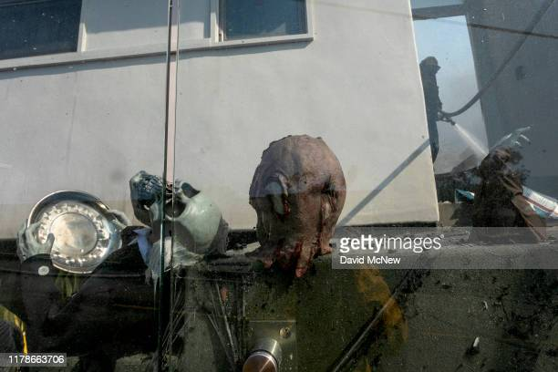 A firefighter hoses down a house decorated for Halloween that was burned in the Getty Fire on October 28 2019 in Los Angeles California Reported at...