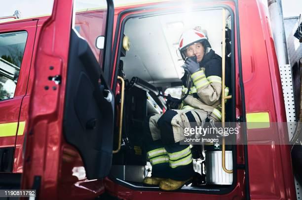 firefighter in car - gender role fotografías e imágenes de stock