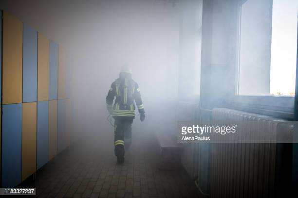 firefighter in fire-rescue operation - fire station stock pictures, royalty-free photos & images