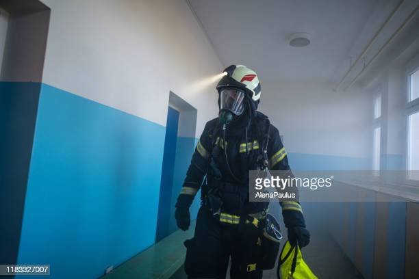 firefighter in smoke, fire rescue operation - in flames i the mask stock pictures, royalty-free photos & images
